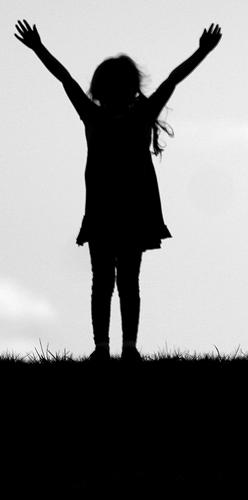 Girl with arms raised in victory